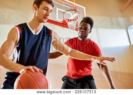 Sporty Handsome Young Multiethnic Athletes Playing Basketball On Court: Concentrated Caucasian Man P