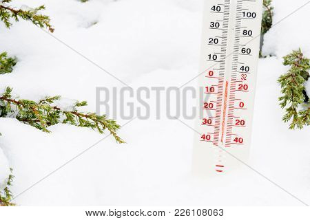 Thermometer Put On White Snow In Winter Garden