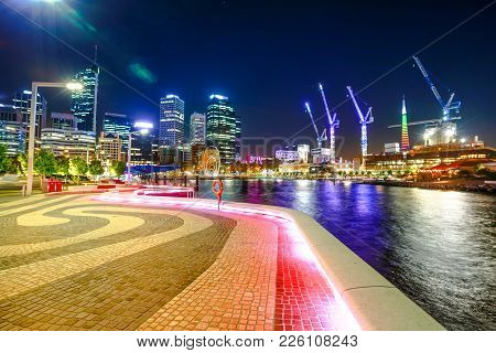 Walkway At Elizabeth Quay Marina, Esplanade With Modern Skyscrapers And Construction Cranes On The S