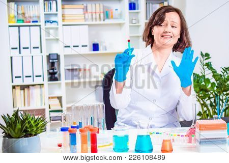 Scientist Or Doctor Holds Syringe In Hands. Handing Stop Hand To Refuse Vaccination. Laboratory Colo