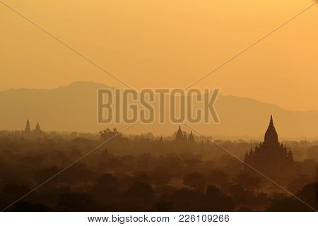 Group Of Ancient Pagodas At The Scenic Sunrise At Bagan Myanmar. Landscape Of Many Ancient Buddhist