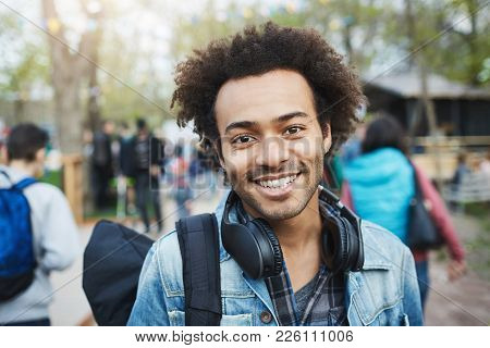 Close-up Shot Of Happy Emotive Young African-american Guy With Afro Hairstyle And Bristle, Smiling B