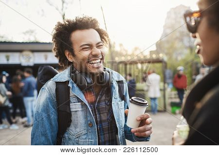 Side-view Portrait Of Fashionable Cute African-american Guy With Afro Hairstyle Laughing Out Loud Ov