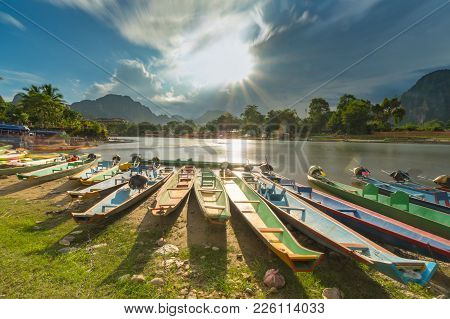 Long Exposure And Long Tail Boats On Naw Song River In Vang Vieng, Laos.