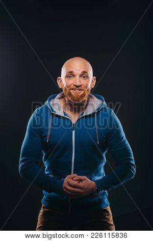 Portrait Of A Young Male Bully Who Starts A Fight Over A Black Background
