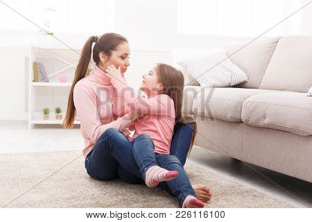 Mother With Cute Little Daughter Having Fun On The Floor In The Bedroom. Mothers Day, Relationship,