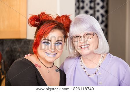 Happy Mother And Daughter Smile In Kitchen