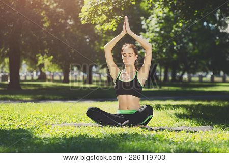 Fitness, Woman Yoga Relax Meditation In Lotus Pose Outdoors, Closeup. Young Slim Girl Making Exercis