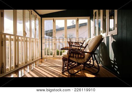 Positive Thinking Concept. Wicker Chairs Or Rattan Chair Light Of The Old Wooden Windows Falls On Wi
