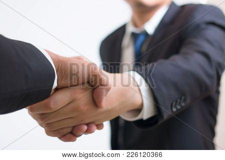 Close Up Investor Businessman Handshake With Partner Vendor. Businessman Shaking Hands Using As Busi