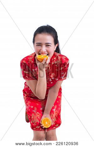 Portrait Of Beautiful Young Asian Woman Wear Chinese Dress Traditional Cheongsam Or Qipao. Eating Or