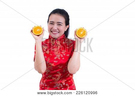Portrait Of Beautiful Young Asian Woman Wear Chinese Dress Traditional Cheongsam Or Qipao. Holding J