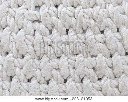 Old Knitted Material Of Intertwined Thick Long Filaments Of Dirty White Color