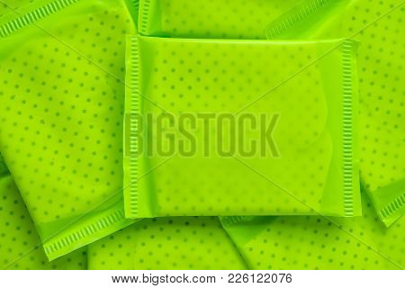 Green Package Of Feminine Sanitary Napkin, An Absorbent Item Worn By A Woman While Menstruating For