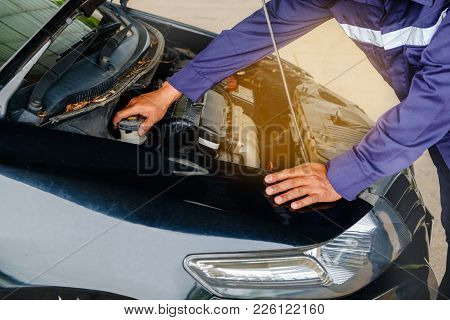 Man In Blue Safety Uniform Checking Car Engine Before The Trip For Vehicle And Transportation Concep