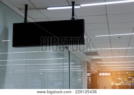 Hanging Black Advertising Billboard Or Light Box Showcase On Wall At Airport Or Subway Train Station