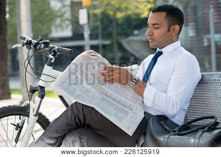 Serious Latin Male Entrepreneur Having Break Outdoors. Concentrated Young Businessman Searching Job