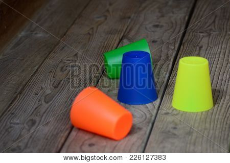 Colorful Plastic Cups On The Wooden Terrace
