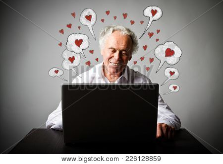 Old Man In White Is Using A Laptop To Browse The Net. Valentine Day And Romantic Love Messages Conce