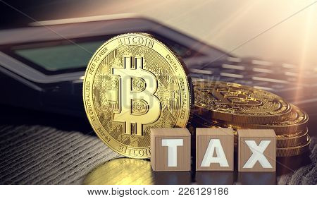 Bitcoin Standing In Front Of Calculator And Next To Wooden Blocks With Tax Letters. Bitcoin Taxation