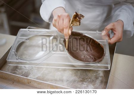 Making Chocolate. . Chocolate Factory. Liquid Chocolate In A Pan.