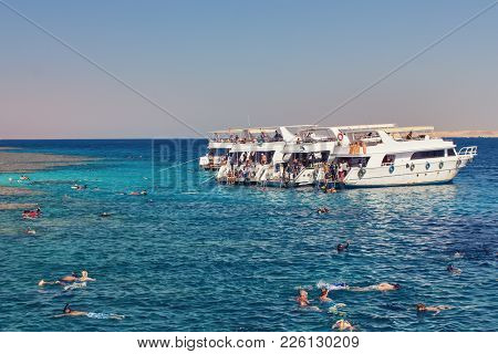 Sharma Sheikh, Egypt, October 22, 2017: Floating People In The Red Sea, Pleasure Boats, Diving And S