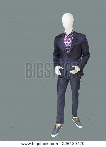 Full-length Male Mannequin Dressed In Blue Jacket And Jeans, Isolated. No Brand Names Or Copyright O
