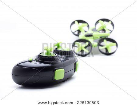 Small green multicopters and control to fly indoors poster