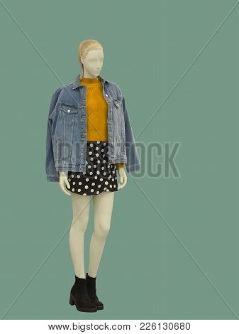 Full-length Female Mannequin Dressed In Casual Clothes, Isolated On Green Background. No Brand Names