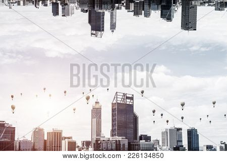 Abstract Image Of Two Modern Urban Worlds Located Upside Down To Each Other With Flying Aerostats On
