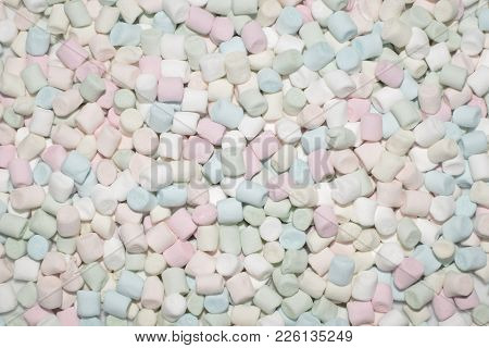 Colorful Mini Marshmallows Background. Fluffy Marshmallows Texture And Pattern. Flat Lay Or Top View