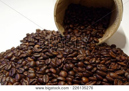 Roasted Coffee Beans And A Wooden Tin On White Background