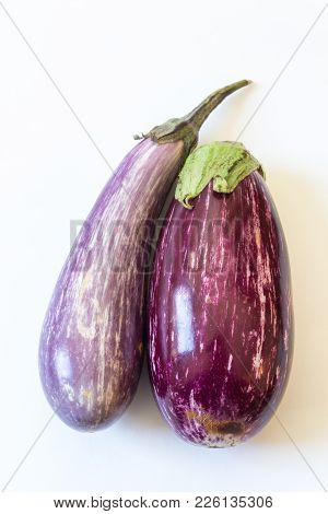 Front View Of Dominican Eggplants Solanum Melongena Food Ingredients, Isolated On White, Vertical As