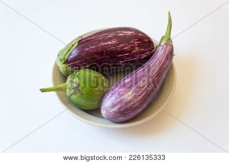 Shallow Bowl With Thai And Dominican Eggplants Solanum Melongena Food Ingredients, Isolated On White