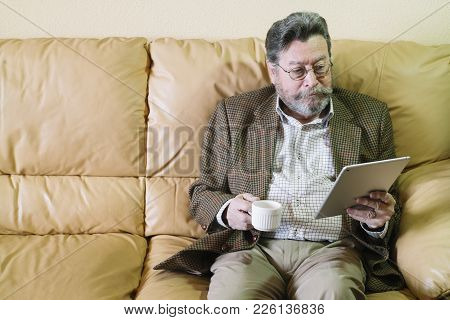 Man Of 72 Years Old Of Age With Tablet