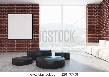 Brick Living Room Interior With A Round Table, A White Sofa And A Square Framed Poster Near A Window