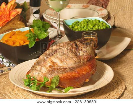 Traditional Sunday Dinner Meal, Oven Roasted Pork With With Crisp Crackling, Carrots And Peas