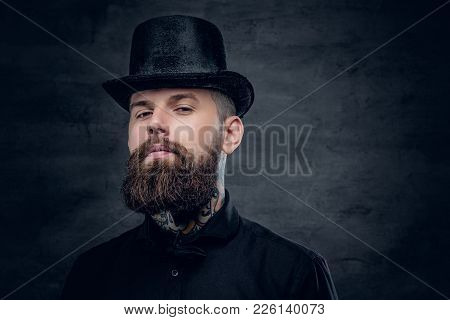 Bearded Male With Tattoo On His Neck And Top Hat Cylinder On Head.