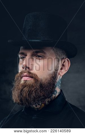 Close Up Portrait Of Bearded Hipster Male With Tattooed Neck And Top Hat Cylinder.