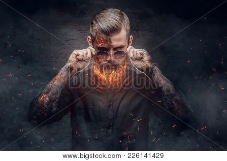 An Evil Man With Burning Beard In Fire Sparks And Smoke.