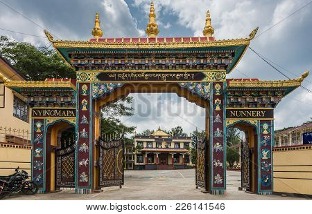 Coorg, India - October 29, 2013: The Elaborate Gate That Leads To Nunnery Of Namdroling Buddhist Mon