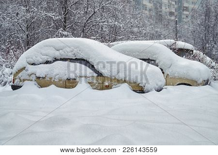Old Russian Cars Buried Under A Thick Layer Of Snow After Snow Storm