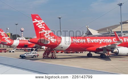 Chiang Mai Thailand - January 27 2018; Parked Air Asia Planes At Airport Through Plane Window, Runwa