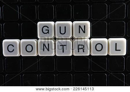 Gun Control Text Word Title Caption Label Cover Backdrop Background. Alphabet Letter Toy Blocks On B