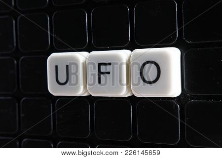 Ufo Text Word Title Caption Label Cover Backdrop Background. Alphabet Letter Toy Blocks On Black Ref