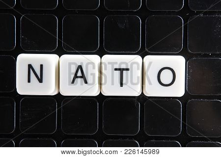 Nato Text Word Title Caption Label Cover Backdrop Background. Alphabet Letter Toy Blocks On Black Re
