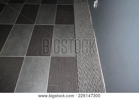 Carpet Tiles Embedded In A Grey Carpet