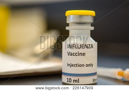 Influenza Vaccine Vial With Syringe Close Up