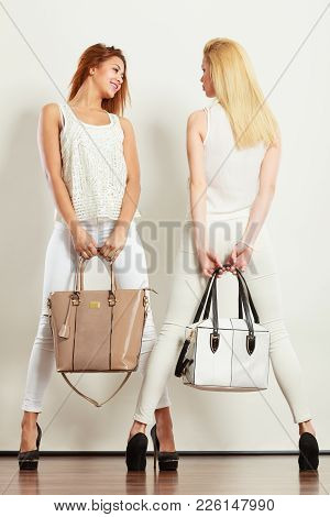 Fashion Concept. Two Women  And Blonde Caucasian Female In White Fashionable Clothes High Heels Shoe