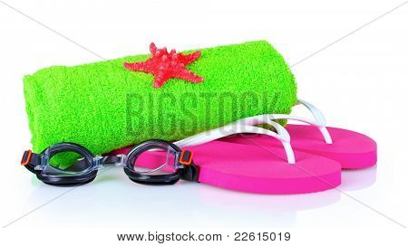 glasses for swimming, towel and beach shoes isolated on white